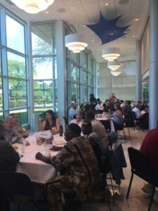 Attendees of the MI OER summit in conversation over their lunches