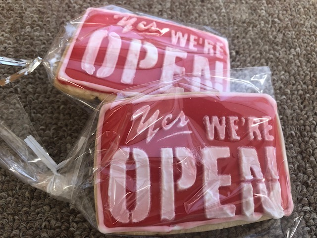 "Cookies decorated with the slogan ""Yes We're Open"""