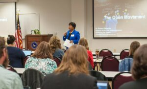 A presenter speaks to an audience at CVCC's OER event.