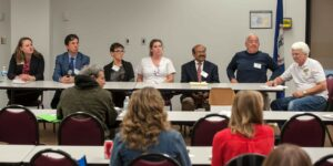 Individuals providing a panel discussion presentation for an audience at CVCC's OER event.